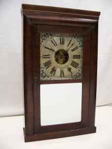 Mahogany veneered mantel clock front.